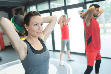 fitness people working with kettle bell in a gym