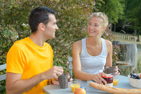 couple having breakfast outdoors Stock Photo