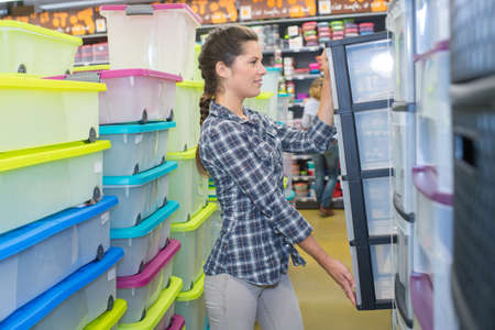 woman bying boxes in supermarket