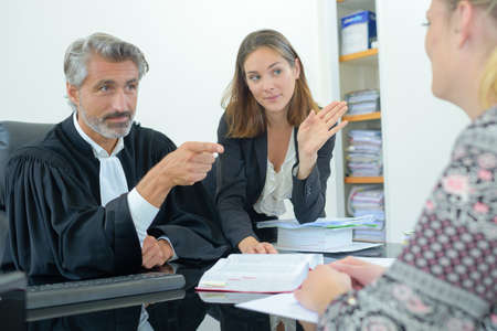 laywers talking to client  in office