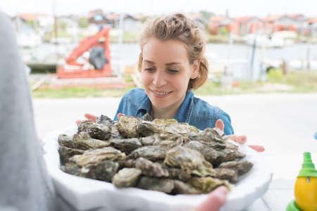 smiling female oyster seller