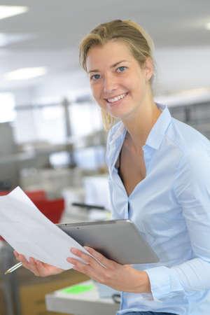 portrait of happy businesswoman holding document