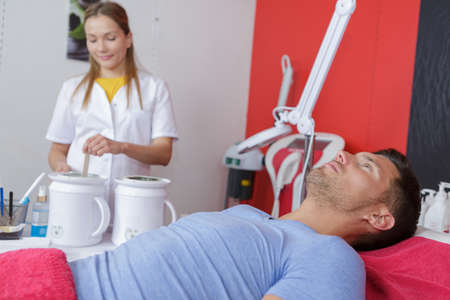 therapist ready to give laser epilation treatment to man