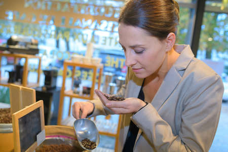 Lady smelling coffee grains