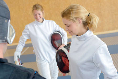 female fencers during break Фото со стока