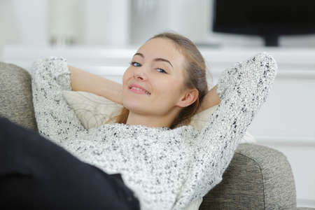 happy young female on sofa