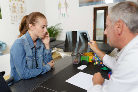 patient explaining neck problems to doctor