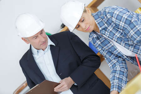male architect talking to female builder