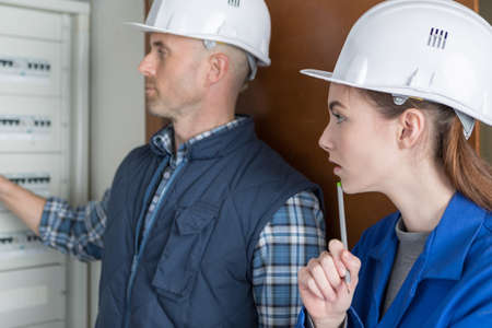 electrician and his apprentice Фото со стока