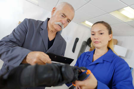 female training apprentice plumber with teacher Фото со стока