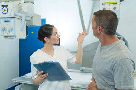 male patient at xray machine with female doctor