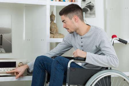 disabled young man enjoying music Фото со стока