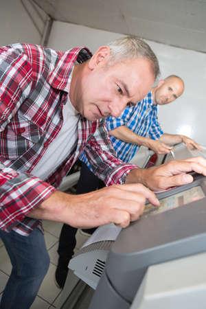 businessman making a photocopy