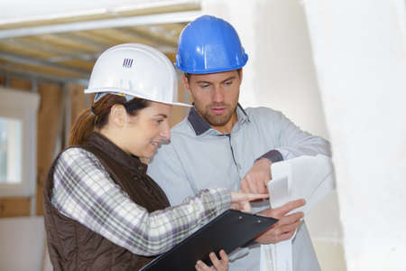 cheerful architects with blueprints Stock Photo