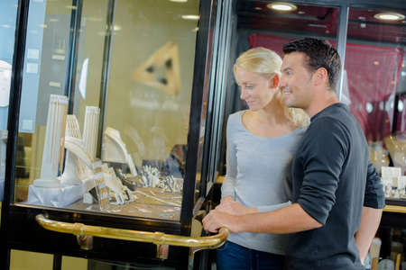couple looking at the display jewelry
