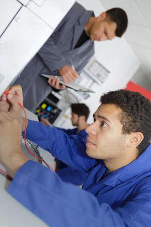 operator checking modern printing machine Фото со стока