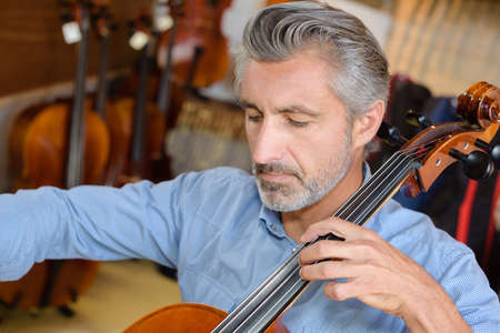 cellist playing the cello