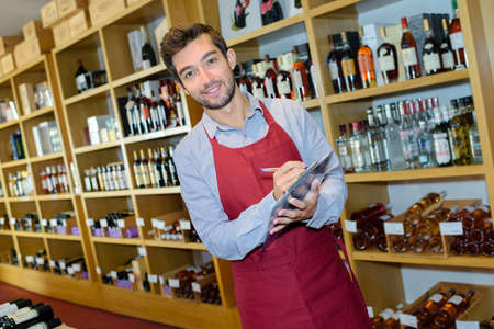 portrait of male wine merchant with clipboard