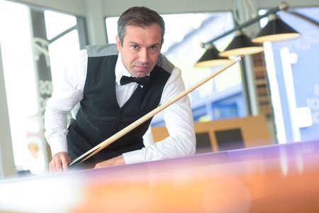 man playing pool Фото со стока