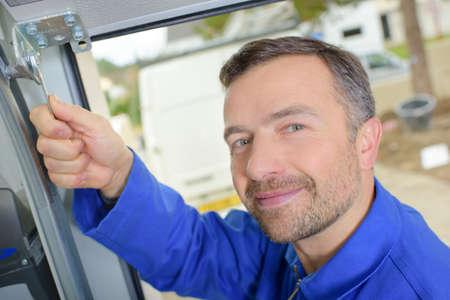 portrait of mechanic using spanner Фото со стока