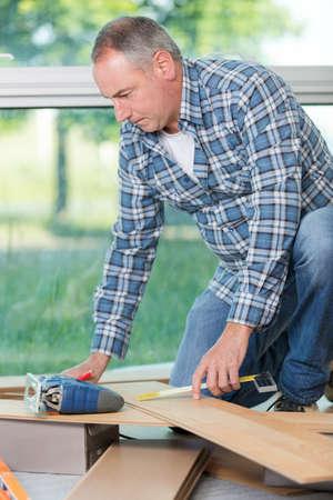 a mature carpenter at work