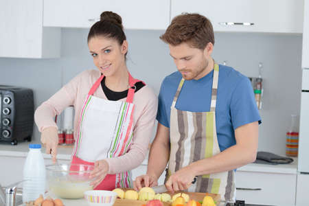 beautiful couple mixing products in the kitchen