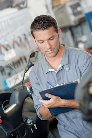 mechanic writing a report