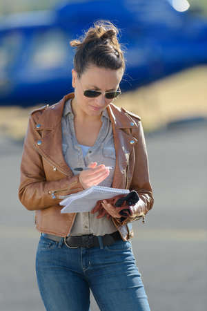 young woman ordering helicopter