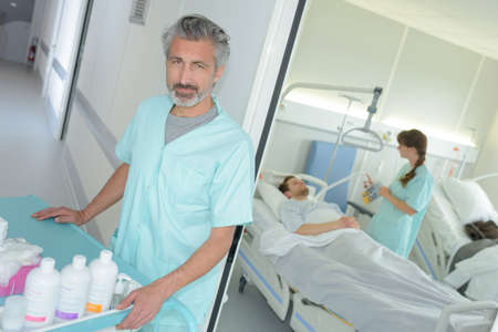 male nurse at work in hospital Stock Photo