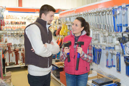 beautiful hardwarestore saleswoman helping customer