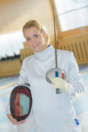 female fencer posing