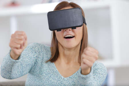 surprised woman using a virtual reality mask