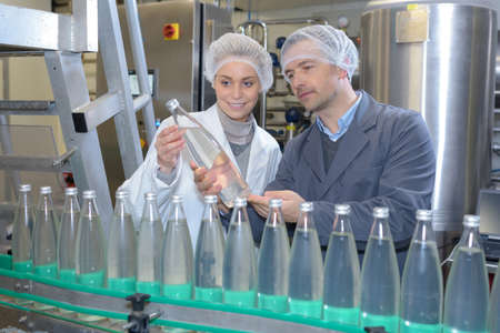 workers at a bottling factory Stock Photo