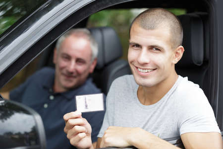 young man happy to get his driving license