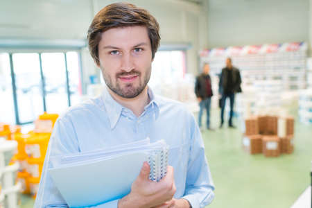 portrait of a businessman in a hardware store