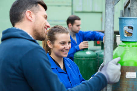 pressurize container workers Stock Photo