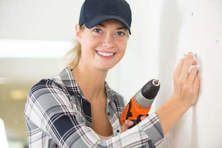 woman using a cordless screwdriver Reklamní fotografie