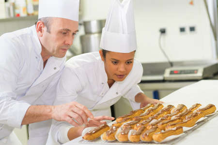 female pastry chef under tuition Stock Photo