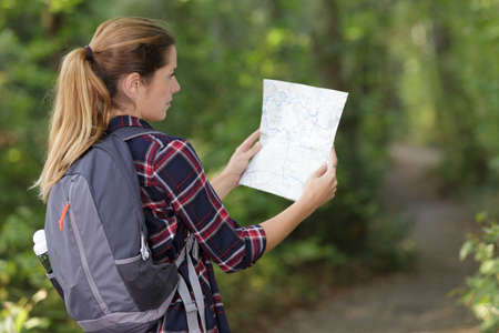 female hiker with a map