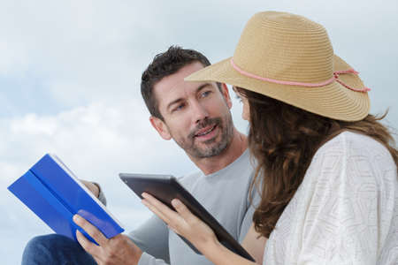 couple using digital tablet outdoor Stock Photo