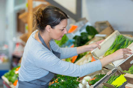 cheerful farmer delivering fresh vegetables