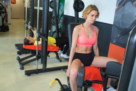 woman working out in gym and training legs