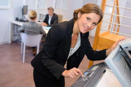 Portrait of woman at photocopier