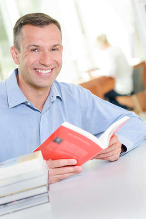 Portrait of man with open book Imagens