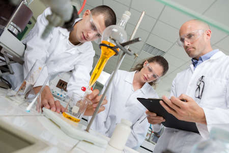 two young scientist doing experiments in lab Stock Photo