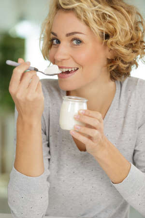 woman eating natural yogurt