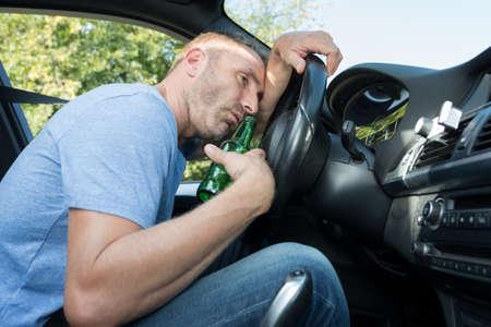 drunk man slumped over the wheel of his car Reklamní fotografie