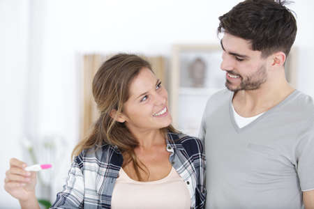 happy couple pregnancy test results