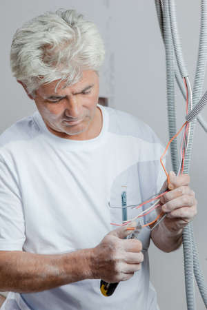 Electrician using a pair of pliers Stok Fotoğraf