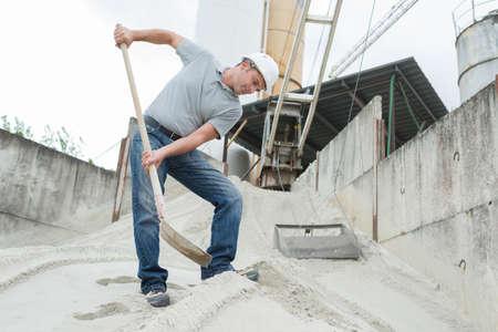 worker shoveling potash